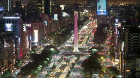 Night Aerial view of the Obelisk (Obelisco) and 9 de Julio Avenue at rush hour time-lapse. Buenos Aires city downtown, Argentina
