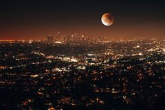 Free Night Aerial View Of City Lights Surrounded By Buildings With A Full Moon In Los Angeles, USA Royalty Free Stock Photos - 200545008