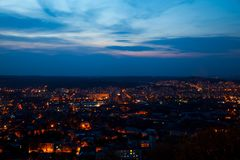 Night aerial view of the populous with many city lights. A Stock Photos