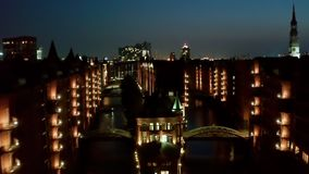 Night Aerial view Speicherstadt is a major tourist attraction in Hamburg and is the focus of most of the harbor tours stock video