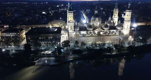 Night aerial view of Zaragoza with Cathedral-Basilica of Our Lady of Pillar on bank of Ebro river, Spain