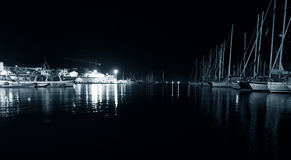 Night Alghero. Night view Alghero from the Mediterranean Sea. Sardinia, Italy. Monochrom Royalty Free Stock Photos