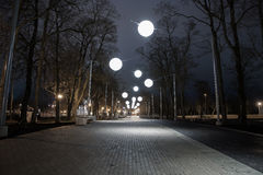 Night alley with bubble lights stock photography