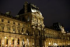 Night amazing Louvre and tourists walking in Paris, France. stock photography