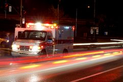 Night Ambulance. Ambulance and emergency equipment at a motor vehicle accident at night Stock Photo