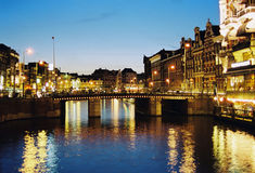Night Amsterdam. Night scene in one of central canals in Amsterdam Royalty Free Stock Photo