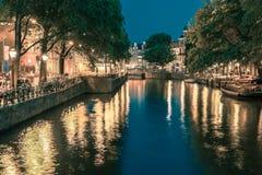 Night Amsterdam canal and bridge Stock Photo