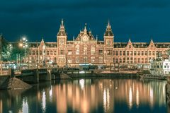 Night Amsterdam canal and Centraal Station Stock Image