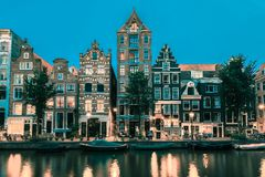 Night Amsterdam canal with dutch houses Royalty Free Stock Photography