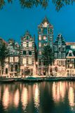 Night Amsterdam canal with dutch houses royalty free stock photo