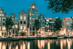 Night Amsterdam canal with dutch houses royalty free stock image
