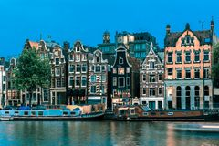 Night Amsterdam canal with dutch houses royalty free stock images