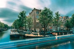 Night Amsterdam canal and luminous track Royalty Free Stock Images