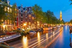 Night Amsterdam canal and Westerkerk church Stock Photos