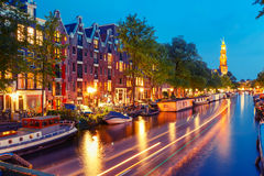Night Amsterdam canal and Westerkerk church Stock Photo