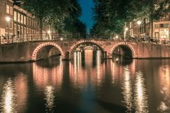 Night Amsterdam canals and seven bridges stock photos