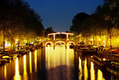 Night Amsterdam center. Night scene on one of central canals with drawbridge in Amsterdam Royalty Free Stock Photos