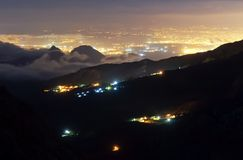 Night Antalya from the mountain. Night Antalya sight from the far mountain with clouds and fog. Turkey Royalty Free Stock Image