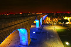 Night at the Aqueduct. A reconstructed aqueduct at a public park in the city of Montpelier, France, at night Stock Images