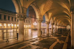 Night arcade, San Marco Square, Venice Stock Photo