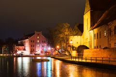 Night architecture in city. Church on the bank of river. Stock Photography