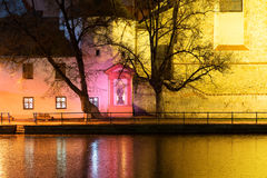 Night architecture in city. Church on the bank of river. Royalty Free Stock Photography