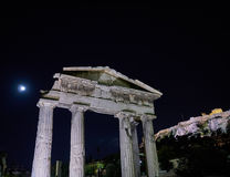 Night in Athens Greece, the entrance of the Roman forum and Acropolis hill. Under the moonlight Royalty Free Stock Photo