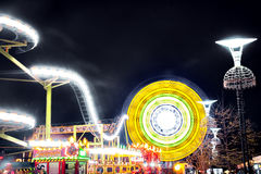 Night attraction amusement park. Blurred lights Stock Photography