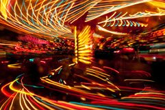 Night attraction carousel whirligig at long exposure Royalty Free Stock Image