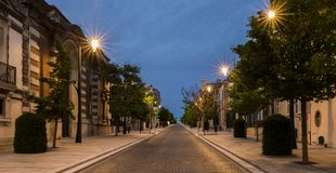 Night Avenue Champagne  Epernay. Avenue de Champagne with several Champagne houses along the road during night and driving car with red lights in Epernay, France Royalty Free Stock Photography