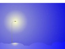 Night background. A streetlight shining at night during a winter snowstorm Stock Image