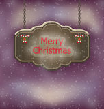 Night background with hanging Merry Christmas wooden board Royalty Free Stock Photo