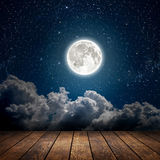Night. Backgrounds night sky with stars, moon and clouds. wood floor. Elements of this image furnished by NASA Stock Photos