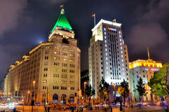 Night of bank building in Shanghai Bund, China. Night view of Shanghai Bund lighting buildings of City Bank and Bank of China, shown as beautiful business city Stock Image