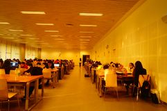 Shenzhen, China: the interior landscape of the library at night. At night, Baoan library interior landscape, readers are still reading, or access to the internet stock image