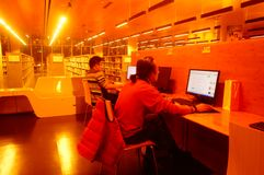 Shenzhen, China: the interior landscape of the library at night. At night, Baoan library interior landscape, readers are still reading, or access to the internet royalty free stock images