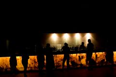 Night bar. People in the bar at night - light and darkness Royalty Free Stock Photography