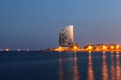 NIGHT BARCELONA - AUGUST 15: city beach, 400 meters long, it one of 10 best urban beaches of the world. Tourists rest along royalty free stock images