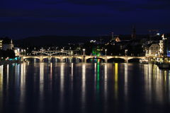 Night of Basel, Switzerland. The night of Basel city, Switzerland. Including the Mittlere Bridge, the main bridge for the Rhein River in Basel city. The river in Stock Image