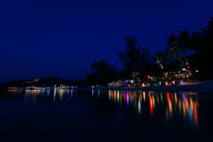 Night beach in lights. Thailand, reflected in water Stock Photos