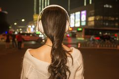 Night beautiful girl back in busy streets Royalty Free Stock Photo