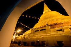 Night beautiful pagoda Thailand. Buddhist traditionally lighting of candle walk on Visakha Puja Day Stock Photos