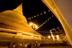 Night beautiful pagoda Thailand. Buddhist traditionally lighting of candle walk on Visakha Puja Day Royalty Free Stock Photos