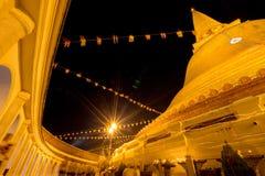 Night beautiful pagoda Thailand. Buddhist traditionally lighting of candle walk on Visakha Puja Day Stock Photo