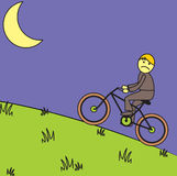 Night bicycle rider. A man go home by using his bicycle in a night time Stock Image