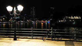 Night bicycle and street lamp Stock Images