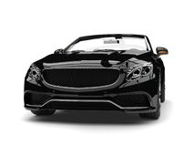 Night black modern luxury convertible car - front view closeup shot. Isolated on white background Royalty Free Stock Photography