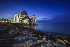 Night and blue hour scene of beautiful Malacca Straits Moqsue. Stock Photo