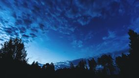 Night blue sky timelapse panorama with stars and clouds stock video footage
