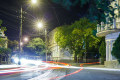 Night and blurry lights of cars on the streets Royalty Free Stock Photo
